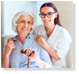 caregiver and elderly patient smiling